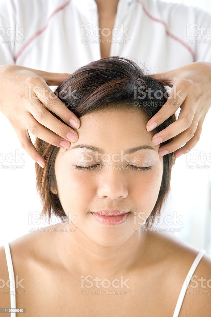 Young female receiving head massage royalty-free stock photo