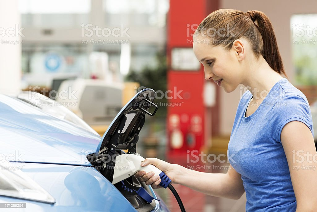 Young Female Refilling Car With Gas Pump royalty-free stock photo