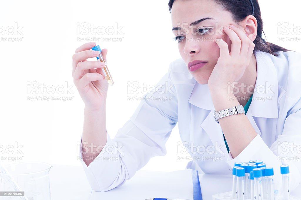 Young female researcher bored on white background stock photo