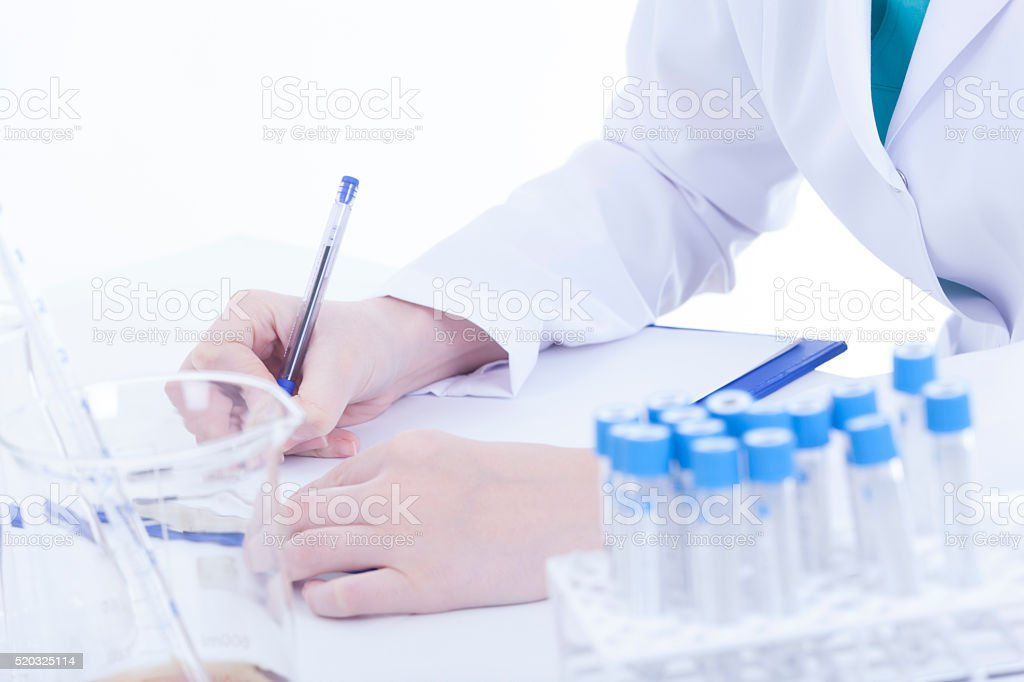 Young female researcher  on white background stock photo