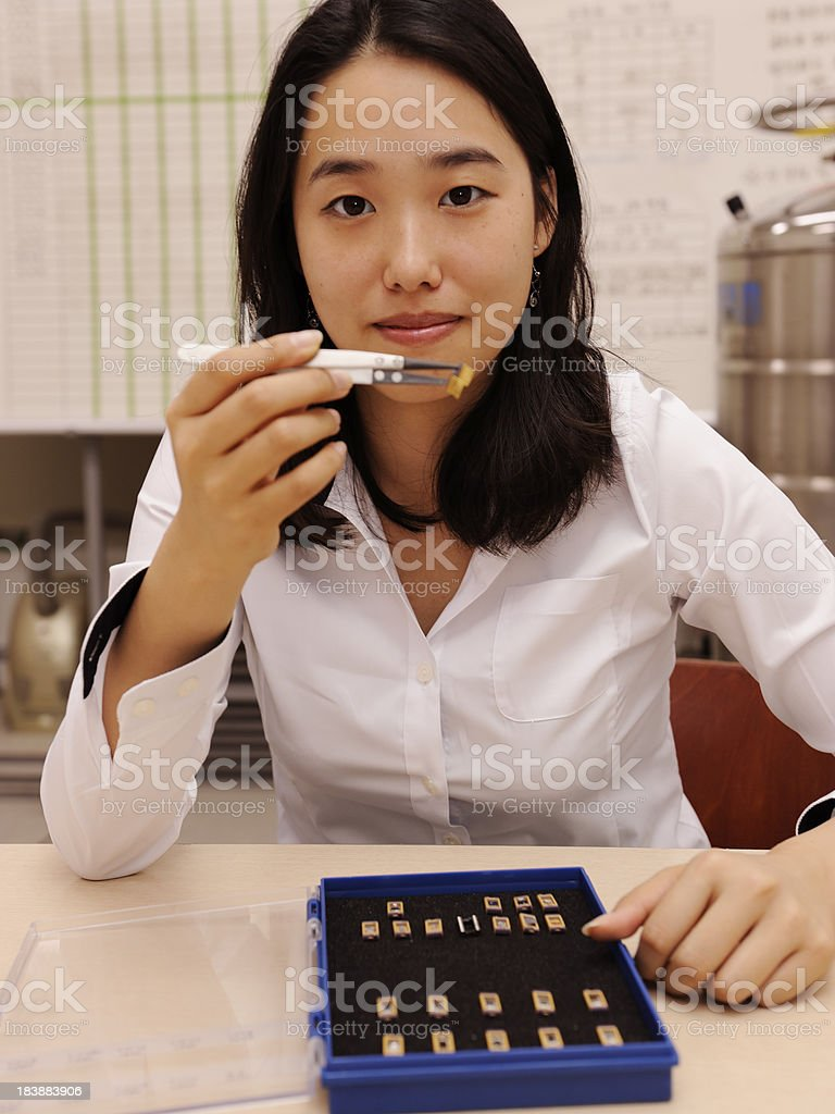 Young Female Researcher working in Laboratory royalty-free stock photo