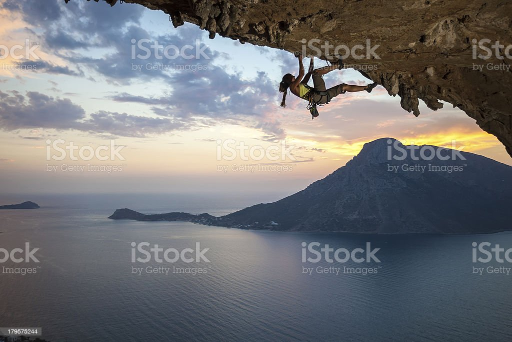 Young female rock climber at sunset royalty-free stock photo