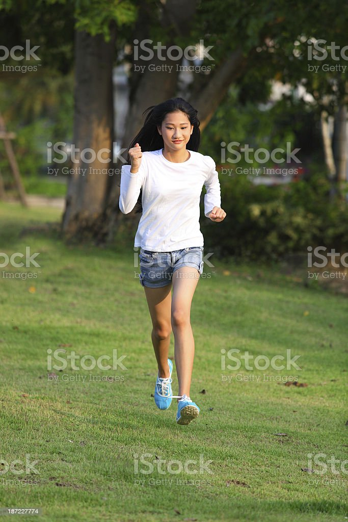 young female  running royalty-free stock photo