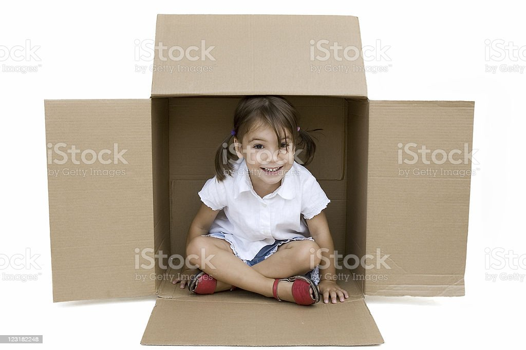 A young female sat inside a cardboard box royalty-free stock photo
