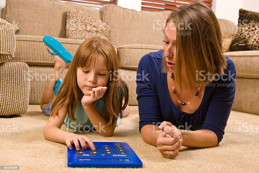 Young female school child and adult tutor royalty-free stock photo