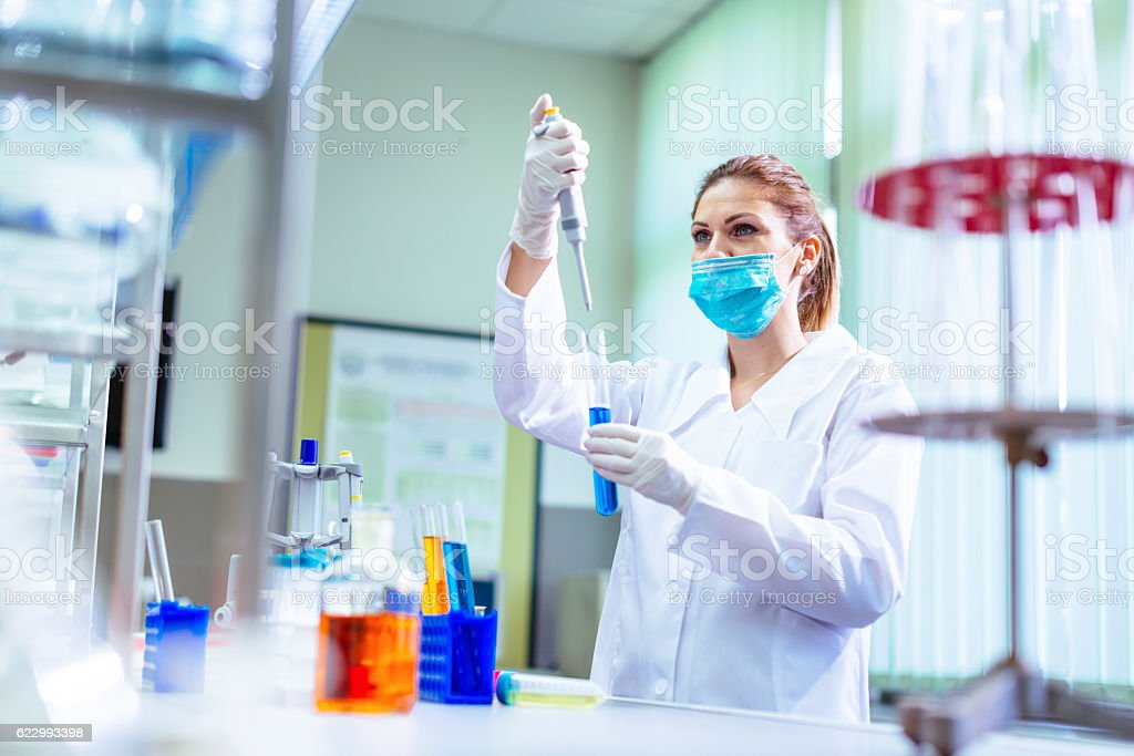 Young female scientist discovering new medical treatments in laboratory stock photo