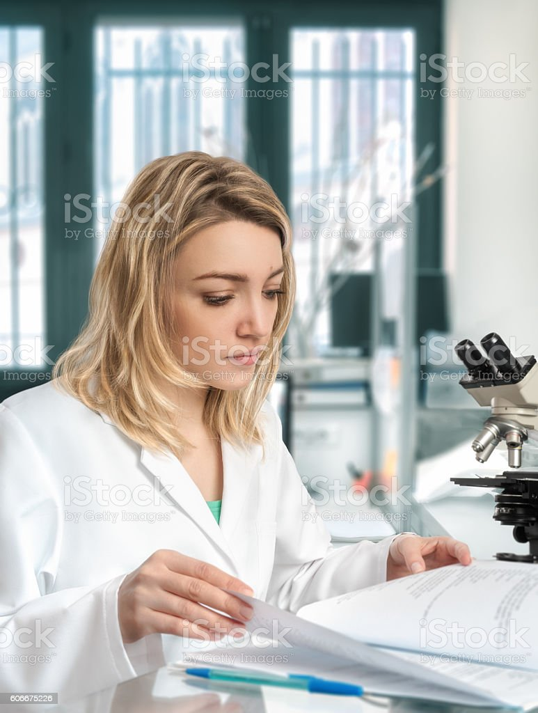 Young female scientist works in modern laboratory stock photo