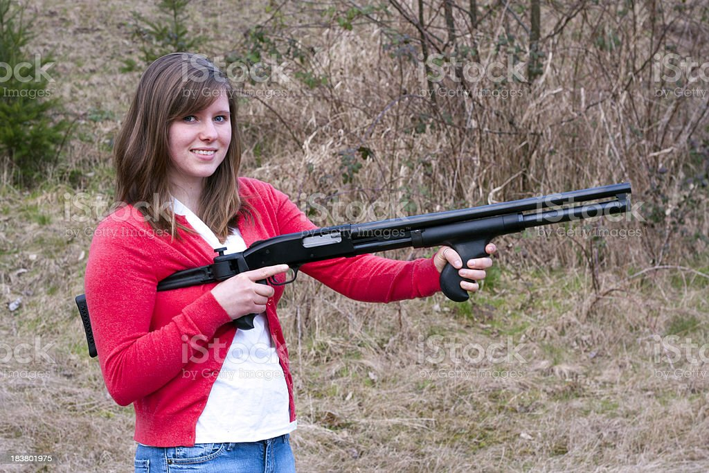 Young Female Shooter With a Shotgun stock photo