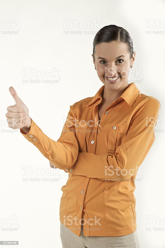 Young female showing success symbol stock photo