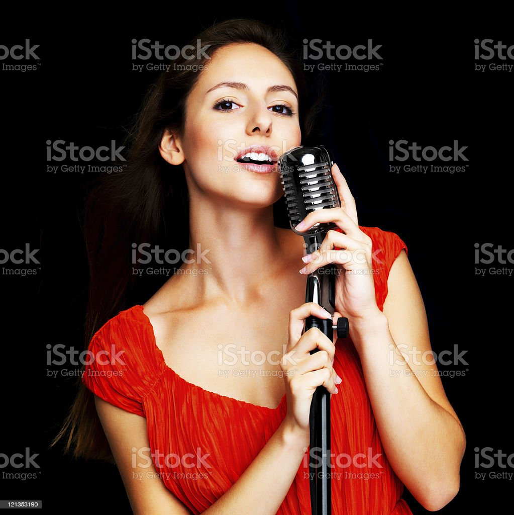 Young female singer performing live in a concert stock photo