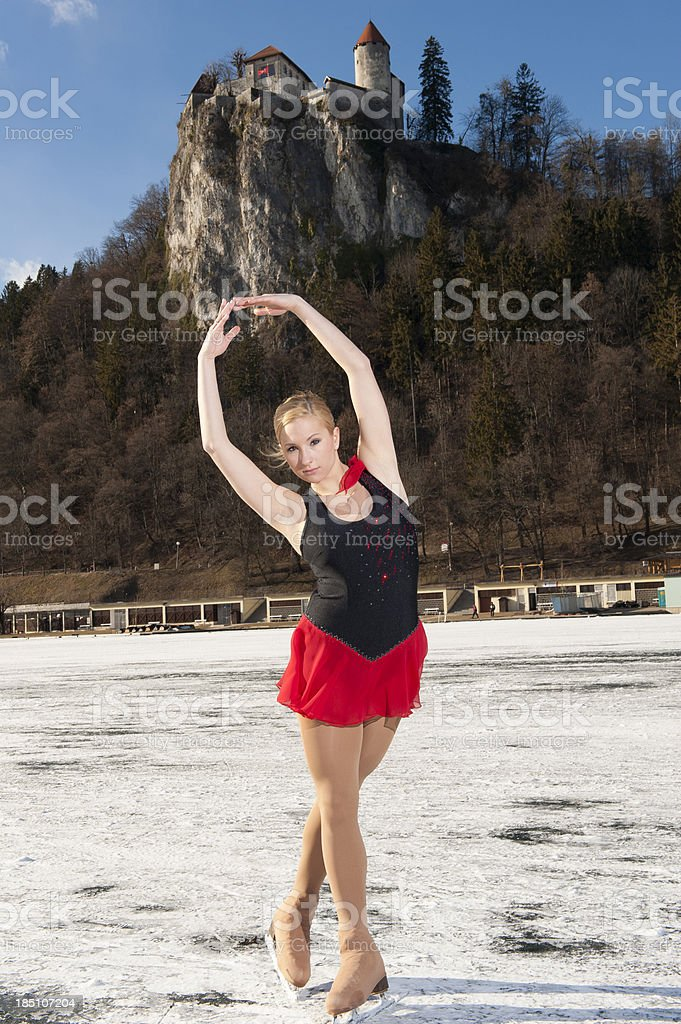 Young female skater posing on the Bled lake stock photo