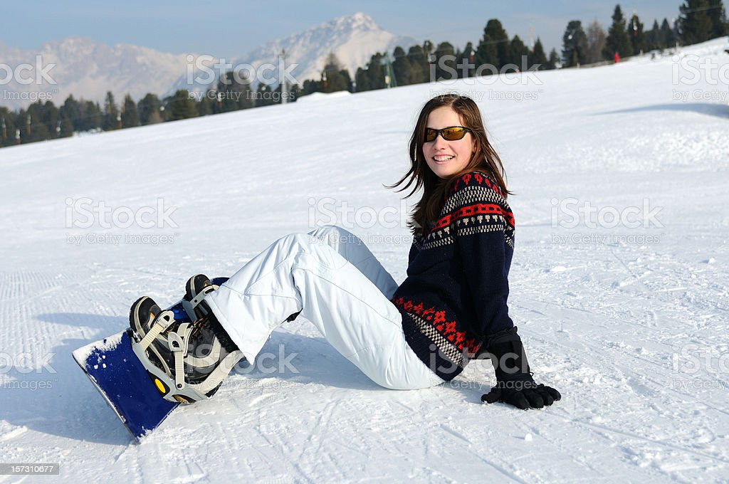 Young female snowboarder royalty-free stock photo