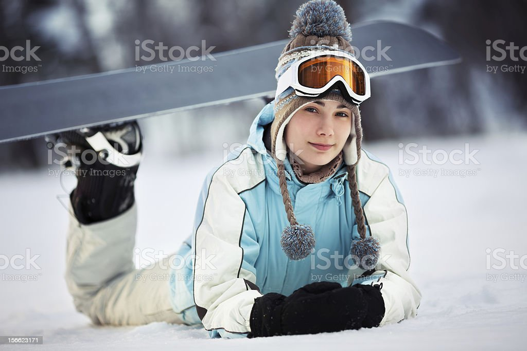 Young female snowboarder resting royalty-free stock photo