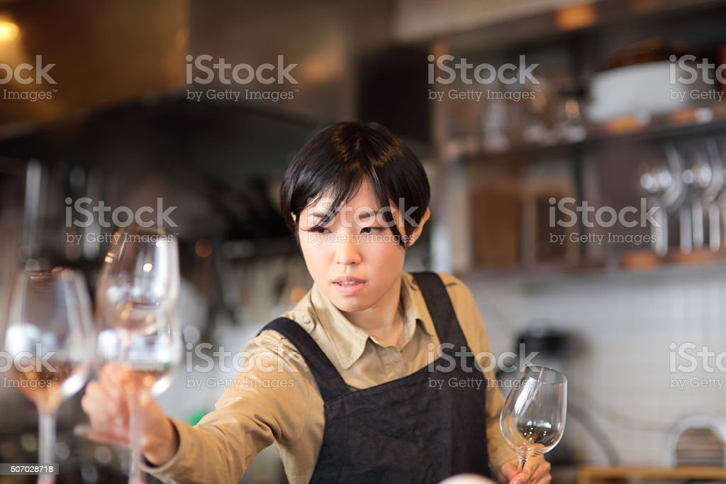 Young female sommelier and the glasses stock photo