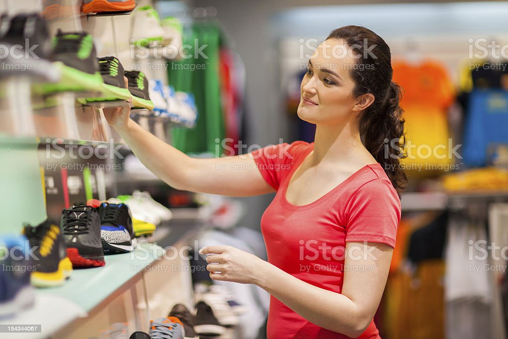 young female sportswear shop assistant royalty-free stock photo