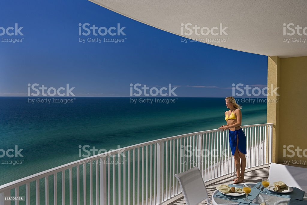 Young Female Standing on Balcony Overlooking Gulf of Mexico royalty-free stock photo