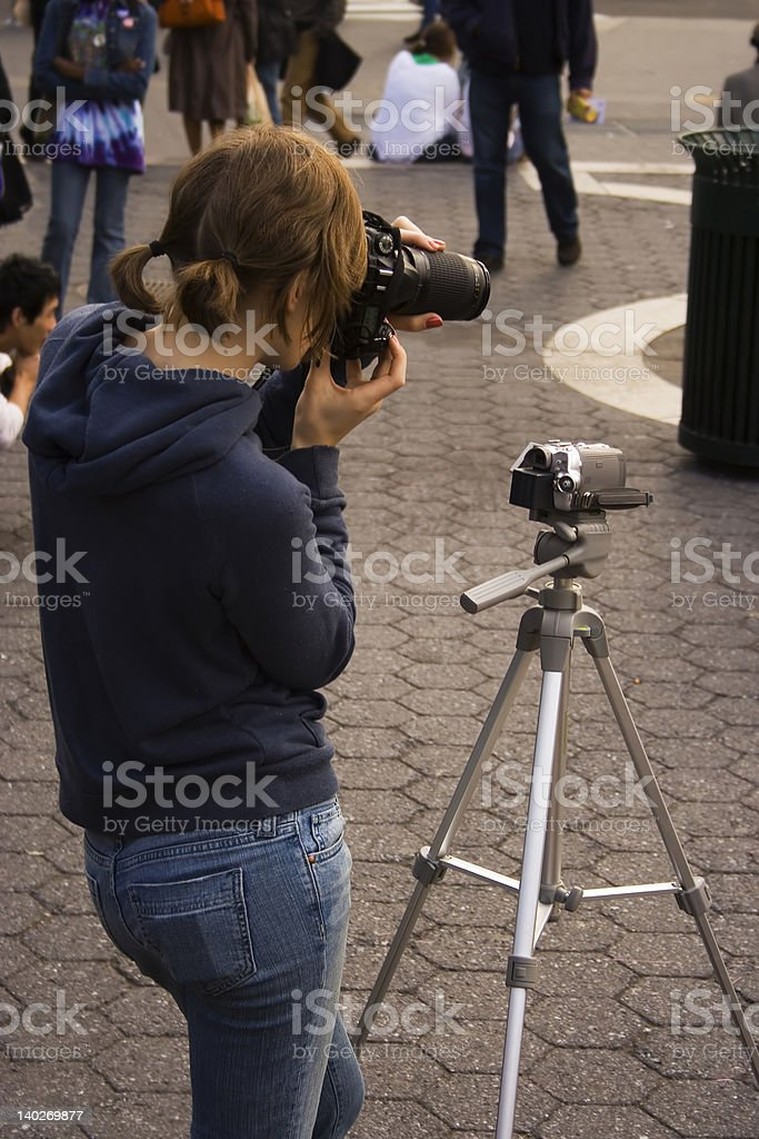 Young female street photographer royalty-free stock photo