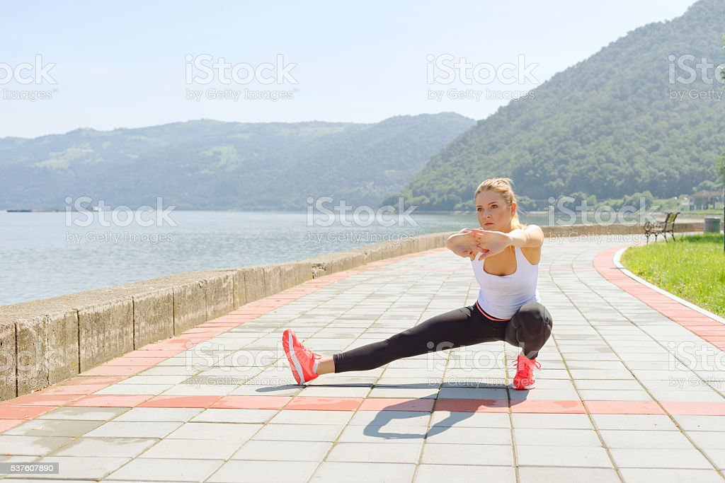Young female stretching stock photo