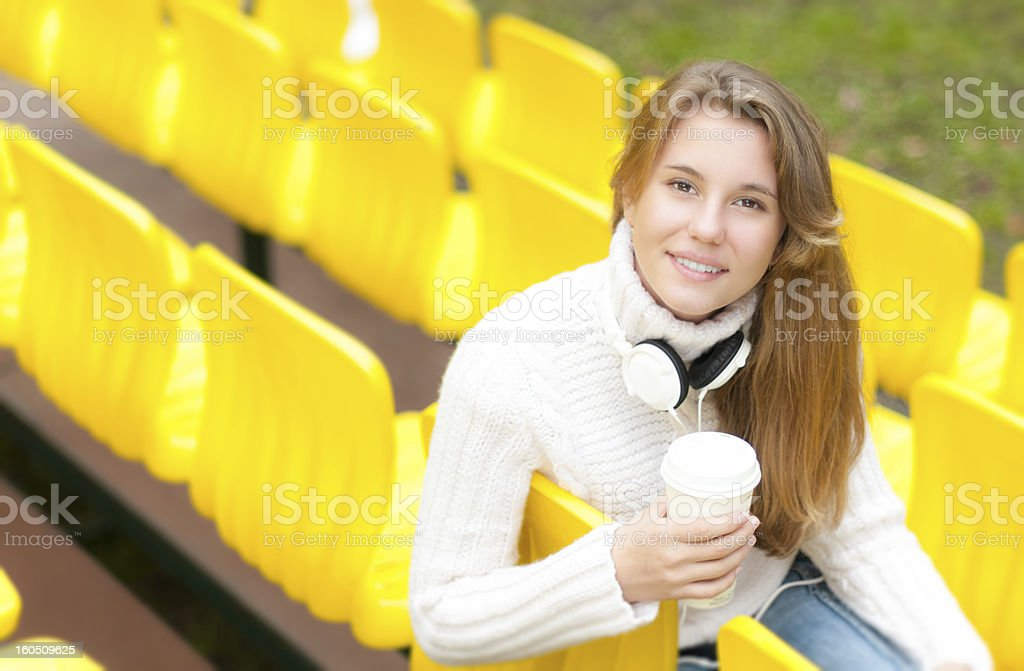 Young female student having rest outdoor. royalty-free stock photo