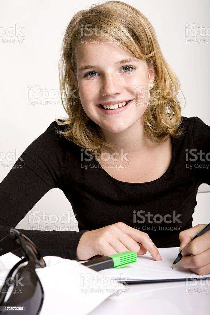 Young female student is working at homework royalty-free stock photo