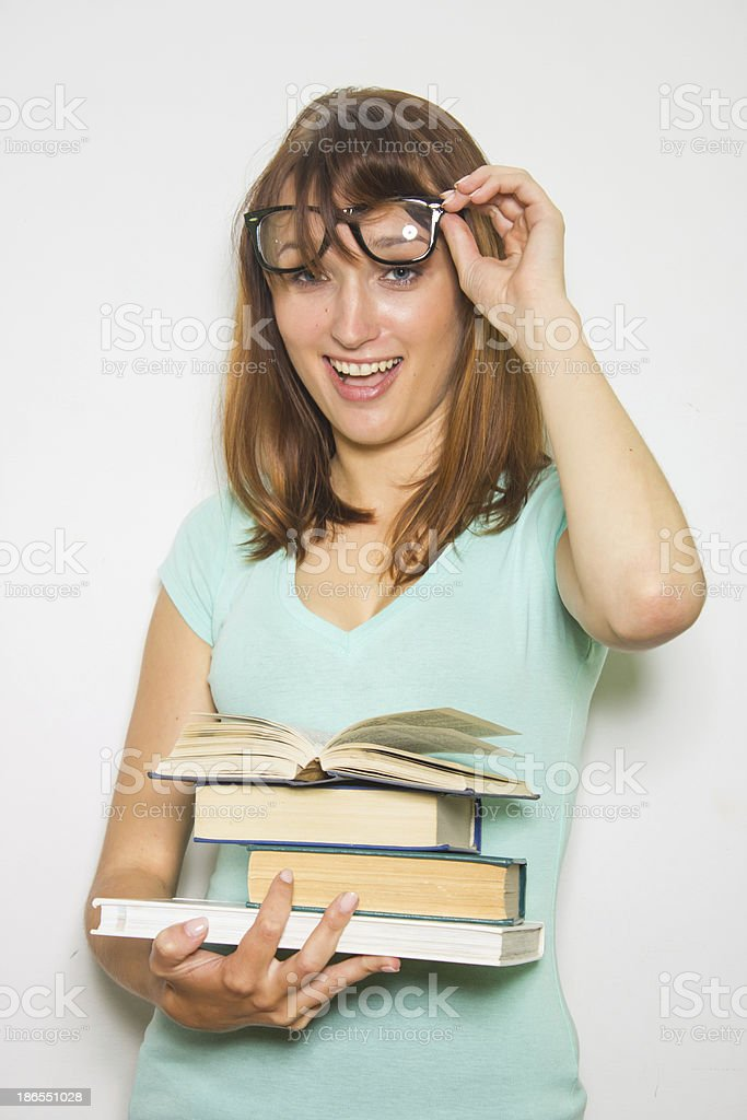 Young female student with books on white. royalty-free stock photo