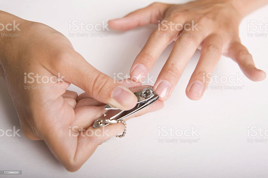 Young female takes care of her nails stock photo