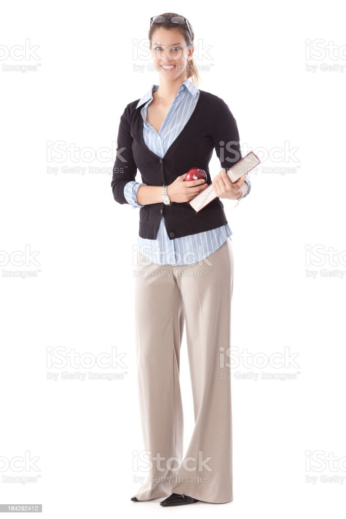 Young Female Teacher Holding Apple and Book stock photo