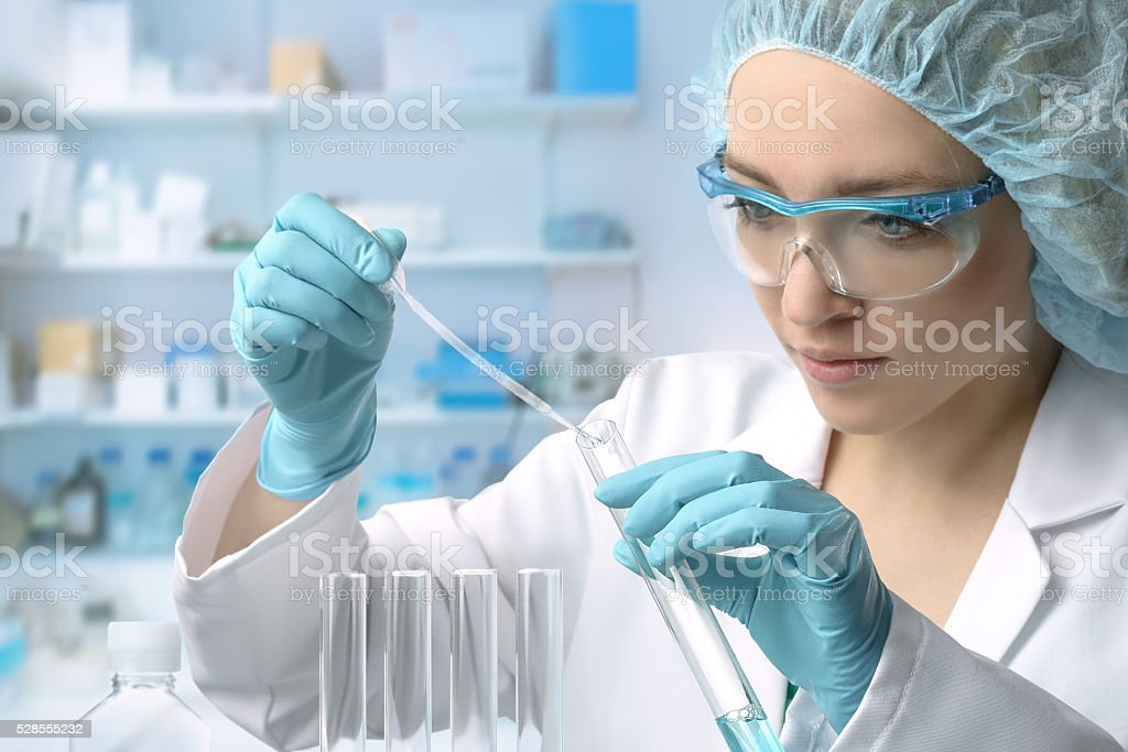 Young female tech or scientist performs protein assay stock photo