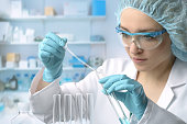 Young female tech or scientist performs protein assay