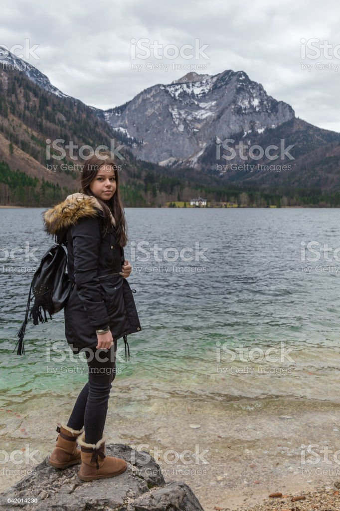 Young female teenager exploring nature stock photo