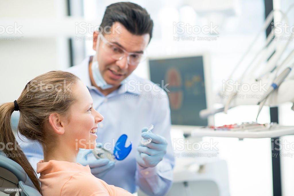 Young Female Teenager getting Invisalign stock photo