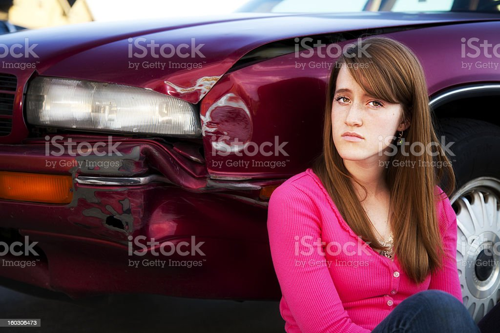 Young Female Teenager Reacts with Defiance to Bent Fender Accident royalty-free stock photo