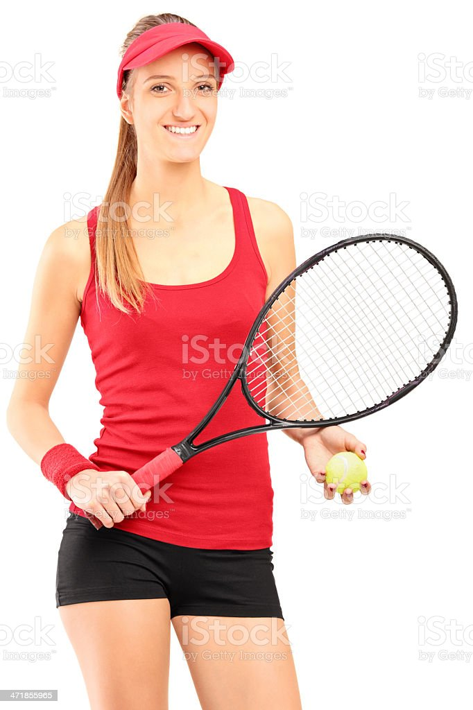 Young female tennis player holding a racket and ball royalty-free stock photo