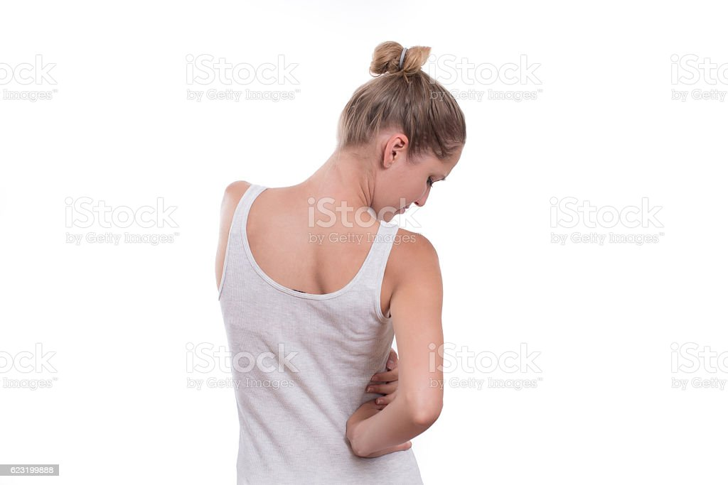 Young female touching right side of body in pain stock photo