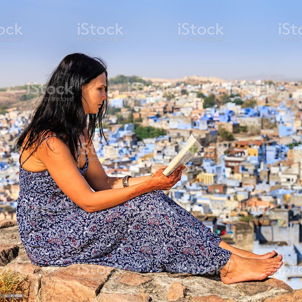 Young female tourist reading book, Jodhpur, India stock photo