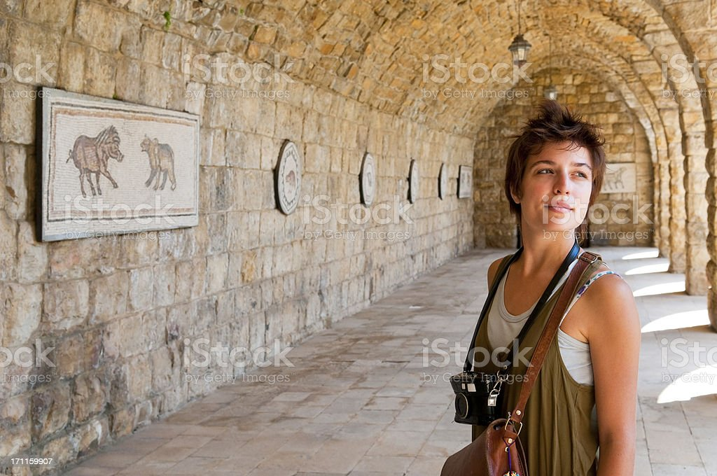 Young female tourist with camera at Beiteddine Palace in Lebanon royalty-free stock photo
