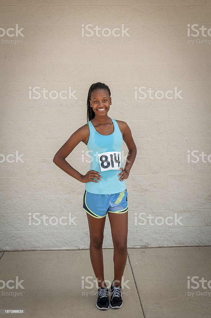 Young female track competitor relaxing after the race (VII) royalty-free stock photo