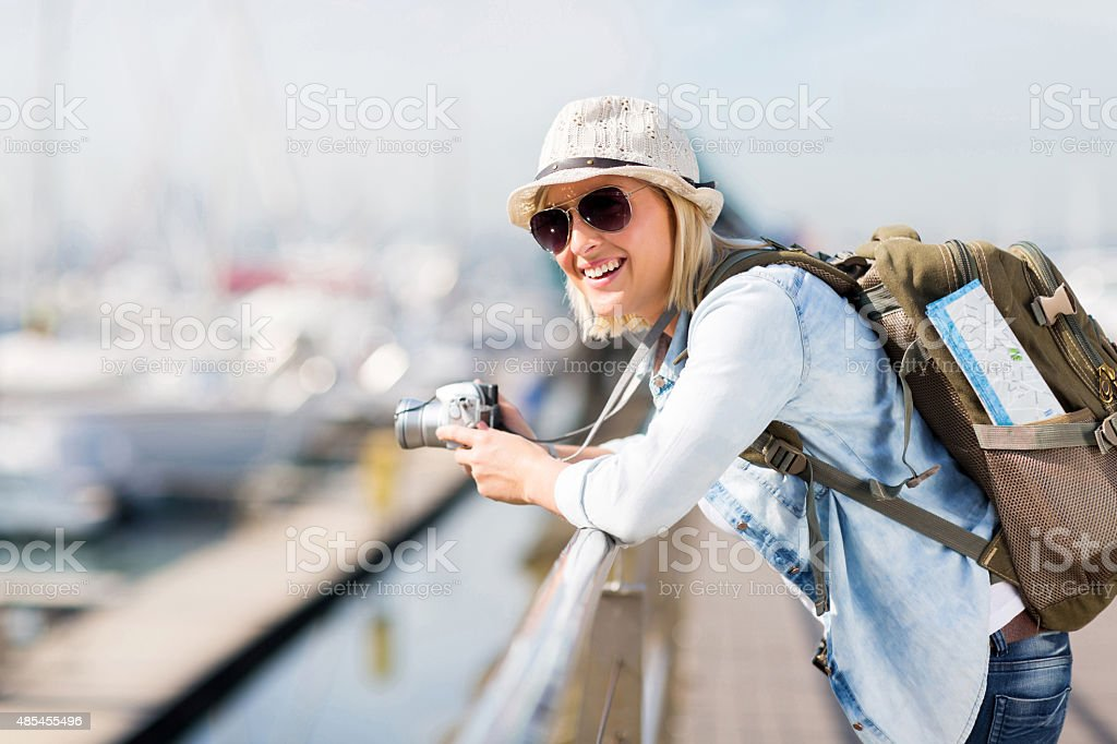young female traveller at the harbour stock photo