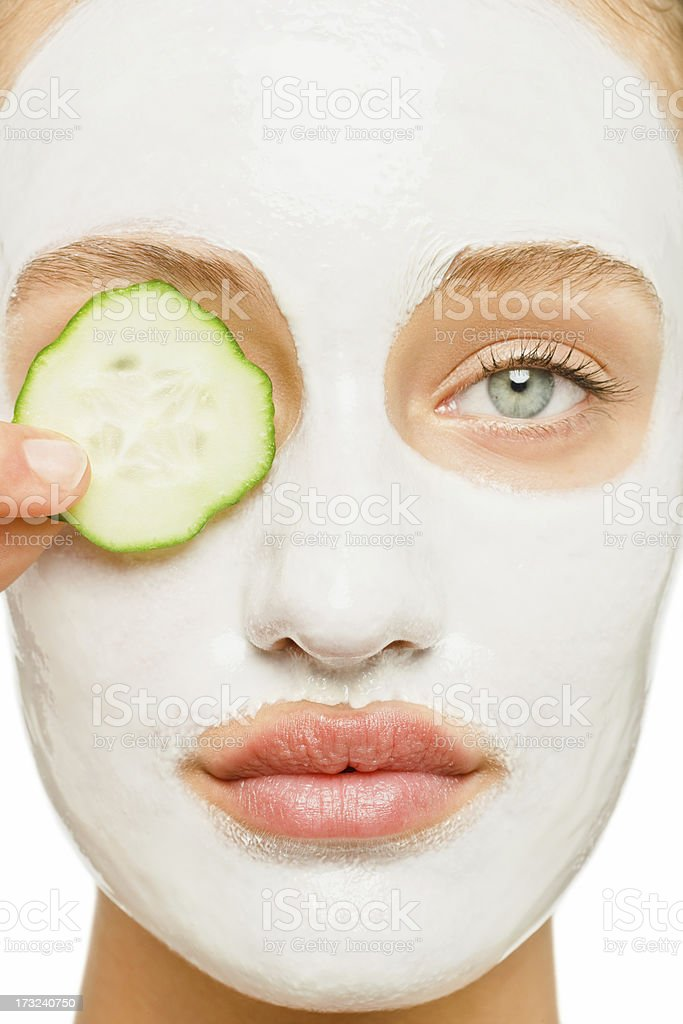 Young female undergoing beauty treatment stock photo