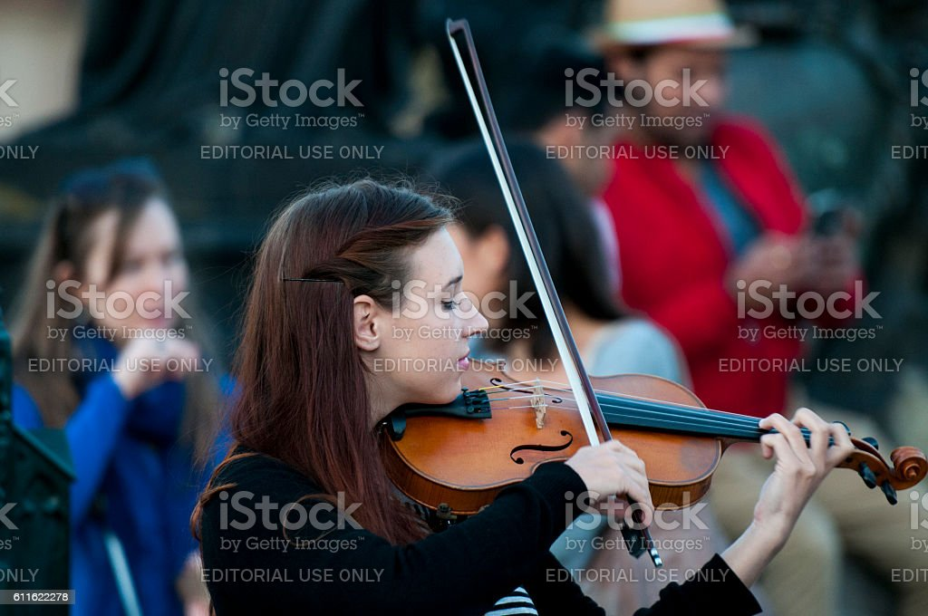 Young female violinist stock photo