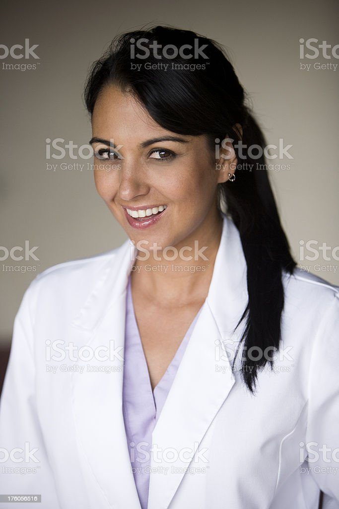 Young female wearing lab coat royalty-free stock photo