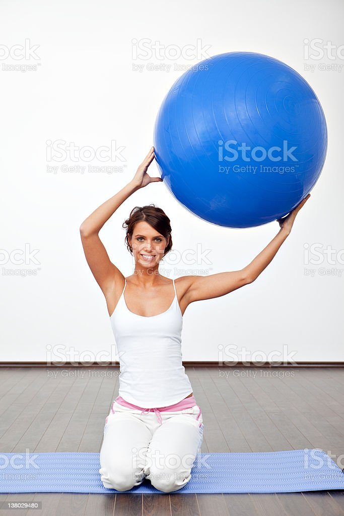 Young female with fitness ball royalty-free stock photo