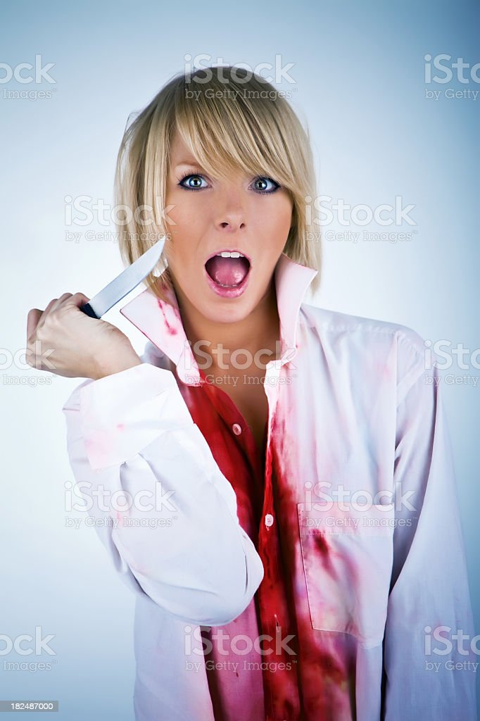 Young female with knife royalty-free stock photo