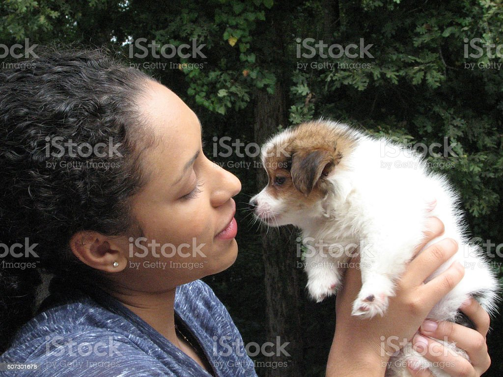 Young female with puppy stock photo