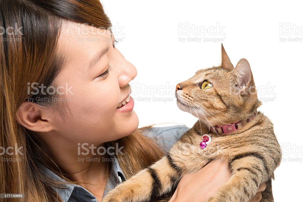 Young female with tabby cat royalty-free stock photo