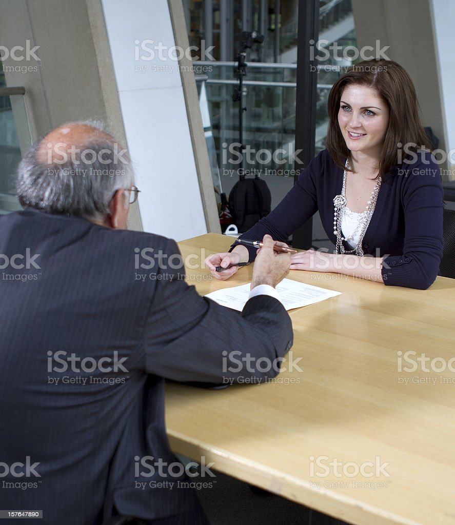 Young Female Worker Receives Glowing Performance Evaluation royalty-free stock photo