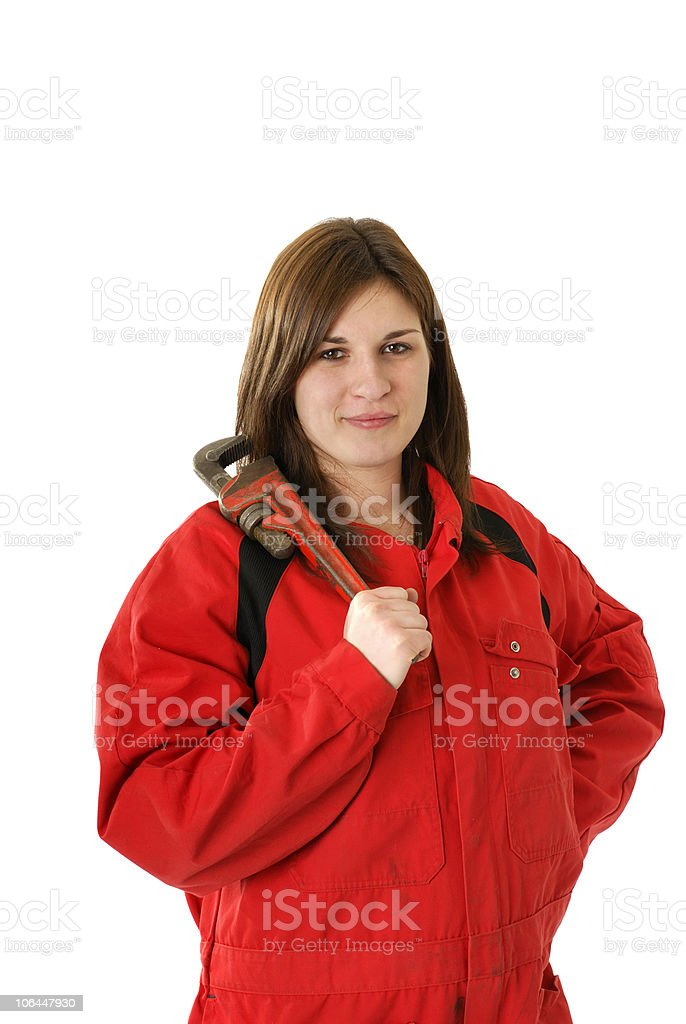 young female worker with crescent wrench stock photo