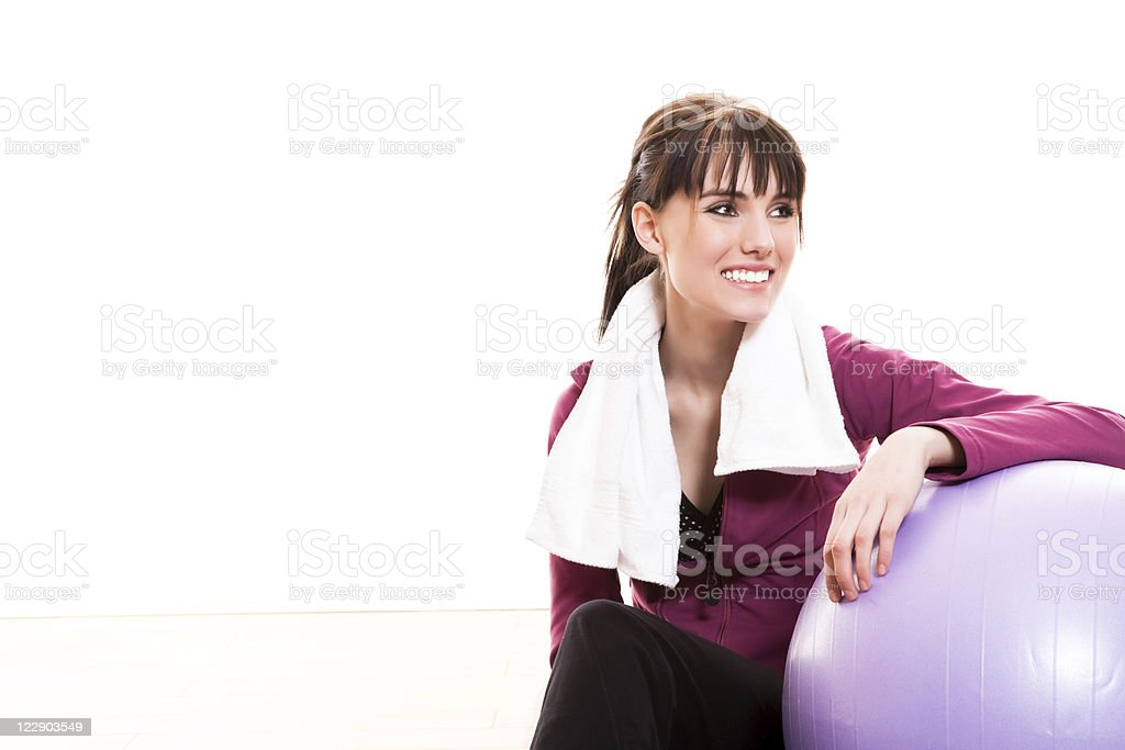 Young female working out with an exercise ball stock photo