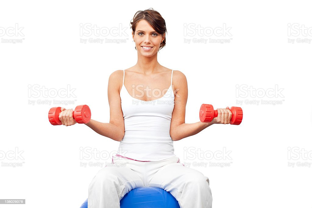 Young female working with fitness ball and dumbbell royalty-free stock photo