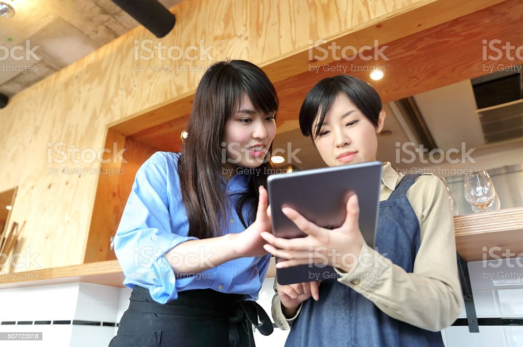 Young female workmates stock photo